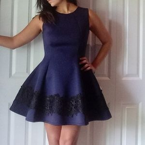 Navy blue fit n flare dress with black lace trim
